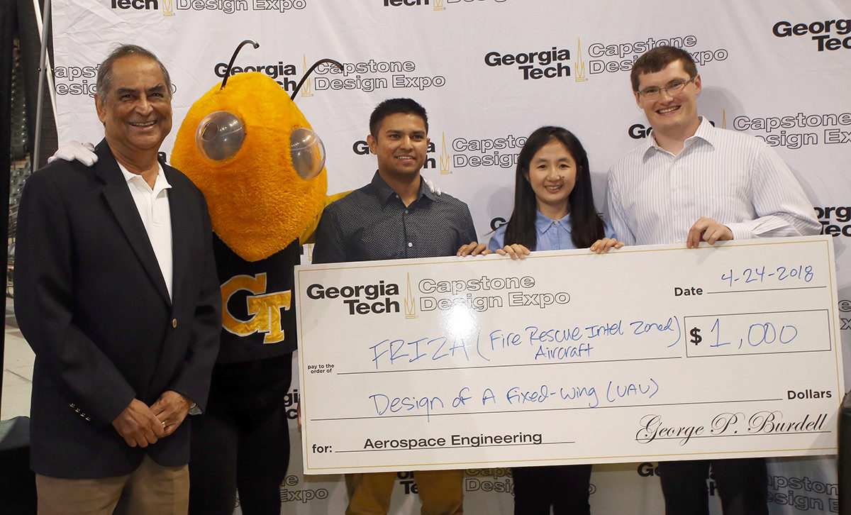 AE prof. Lakshmi Sankar joins three members of the TEAM Firenza as they accept their check