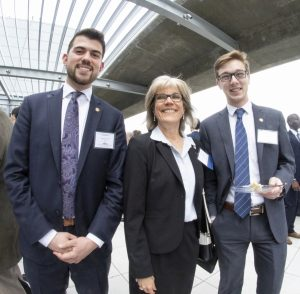 Two students with Lockheed Martin executive Beverly Baughman