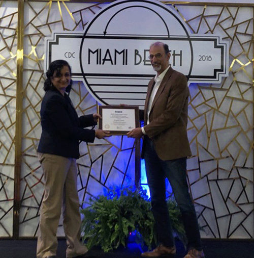 Panos Tsiotras receiving the CSS Award for Technical Excellence in Aerospace Control during the Miami, Florida IEEE conference