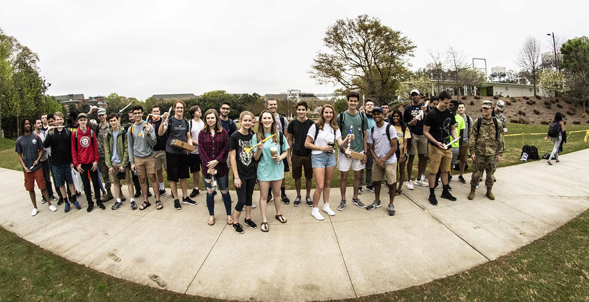 Students in 1601 lined up with their rockets for the first-ever rocket competition