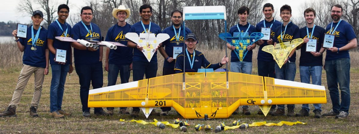 The Georgia Tech Design Build Fly Team poses with their 1st place and 2nd place planes