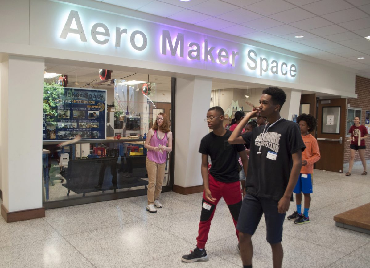 Students testing out their gliders in front of the Aero Maker Space