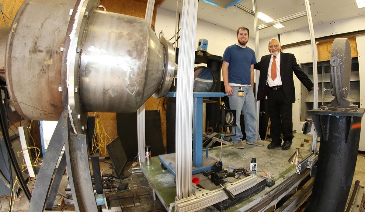 Ahuja in the lab with his former doctoral student, Nick Breen (now a research engineer)
