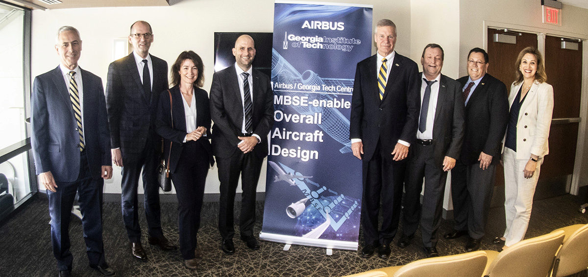 President Peterson, and Dean McLaughlin  with the Airbus executives at the signing ceremony