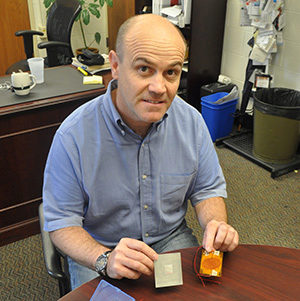 Prof. Ruzzene with some sensors his lab developed