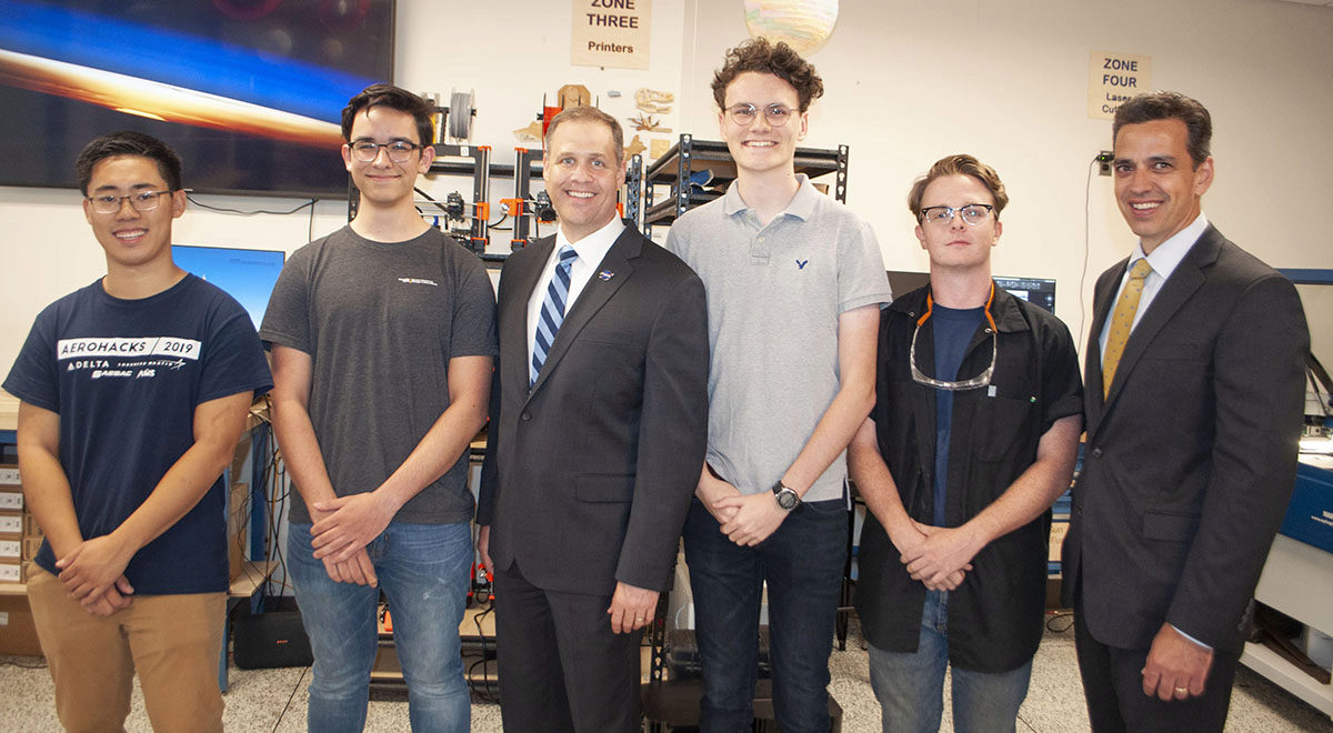 Jim Bridentstine and Congressman Tom Graves with four Aero Maker Space students