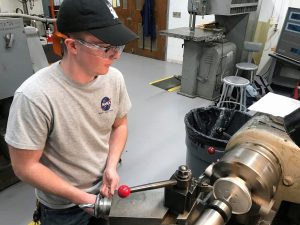 AE undergrad Carson Coursey working in the machine shop