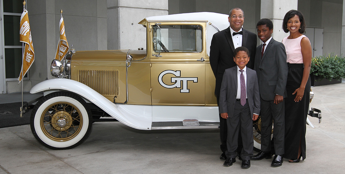 Christopher Jones and family pose with the Ramblin' Wreck