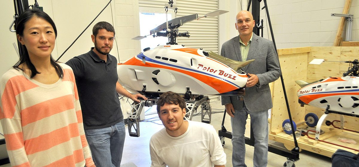 Prof. Costello with four students in his UAV lab