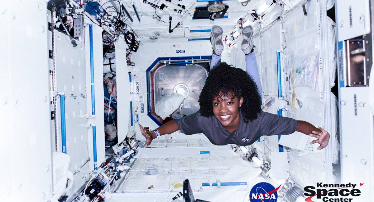 Naia Butler Craig floating in a simulated ISS