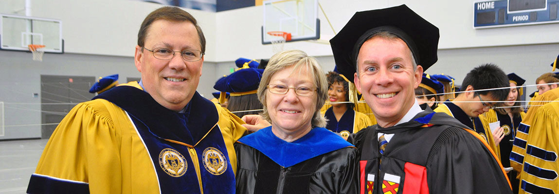 Three AE professors in their graduation robes