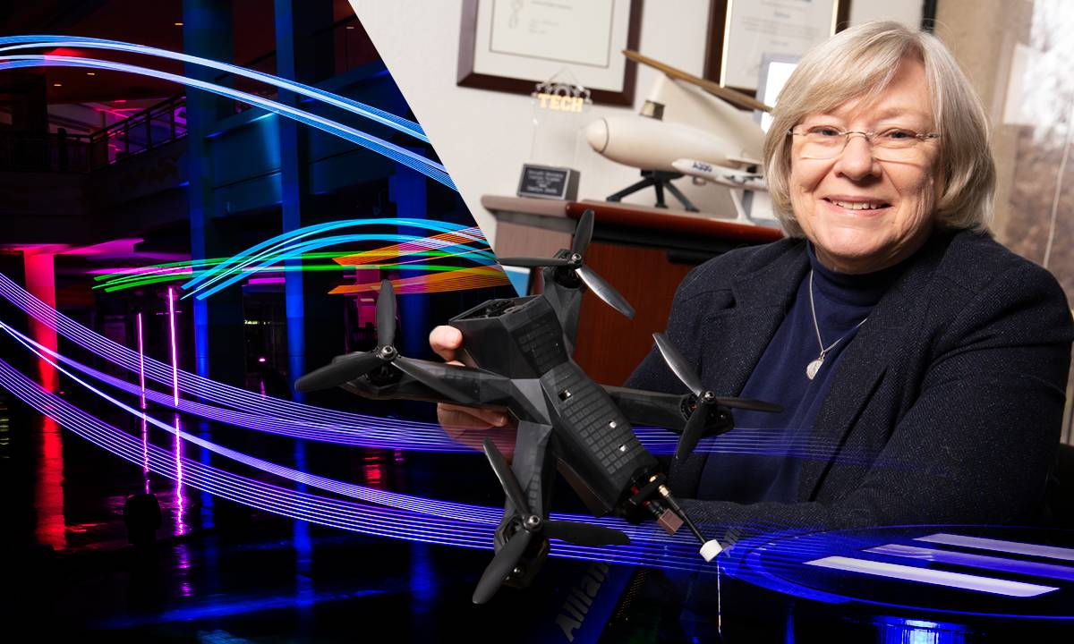 aerospace engineering professor, Marilyn J. Smith, poses with a drone vehicle