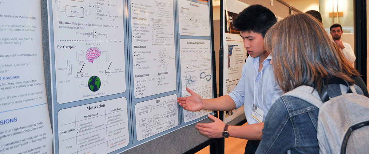 Gabriel Nakajima An shows another student his research poster