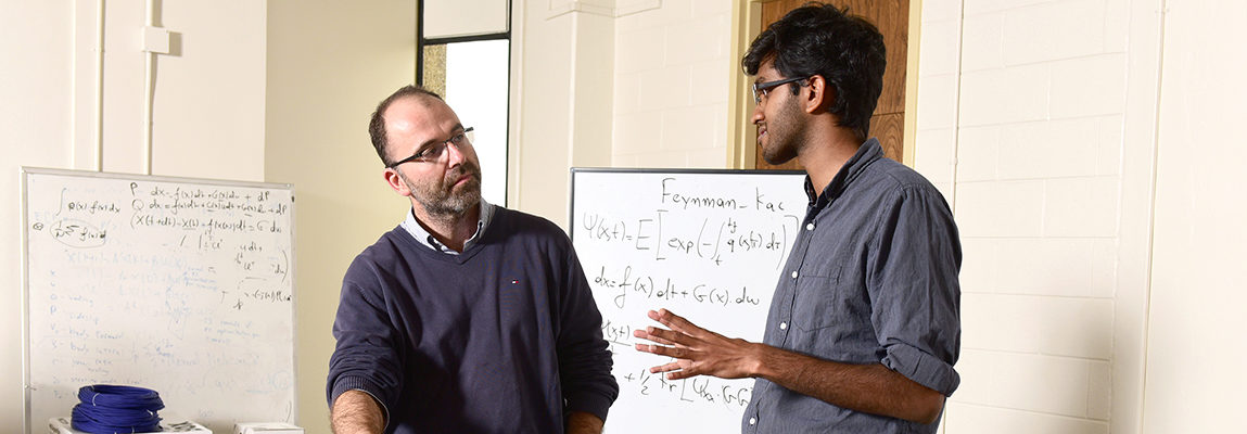 Professor Theodorou with a graduate student during an advising session.