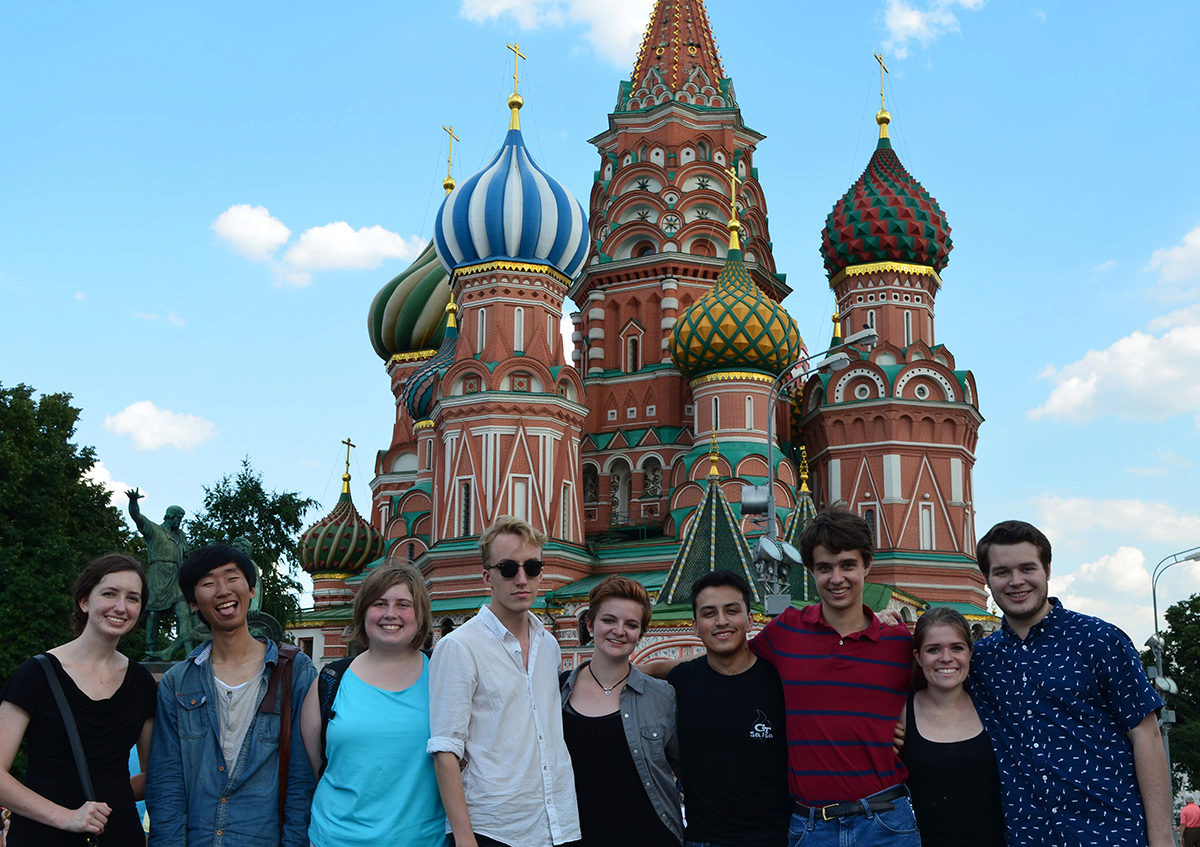 A group of students standing in front of an ornate Russian church