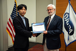 Prof. Koki Ho accepts DARPA award from DARPA program manager Michael Fiddy