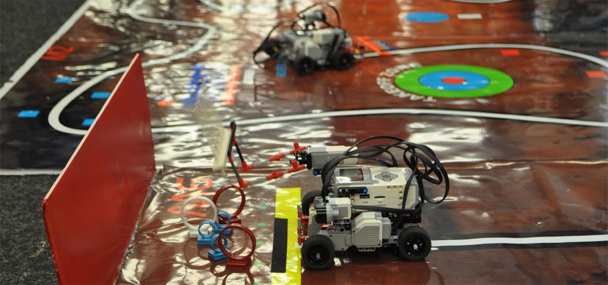 IMEET rovers programmed by high school students attempts to collect rings