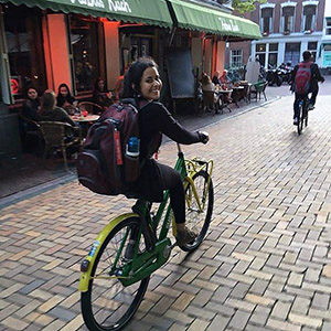 Student riding a bike in a foreign country