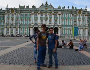 Nelson Guecha and a friend in front of an ornate building in Russia