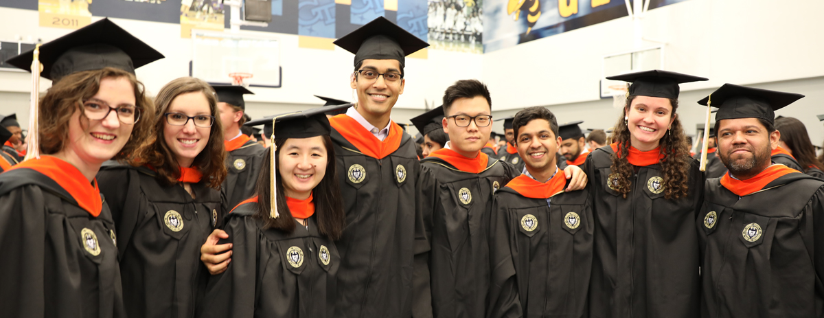 Eight students prepare to graduate with their master's degree in aerospace engineering