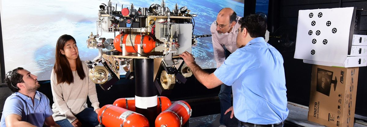 Professor Tsiotras and 3 students working in the Dynamics and Control Systems Lab (DCSL)