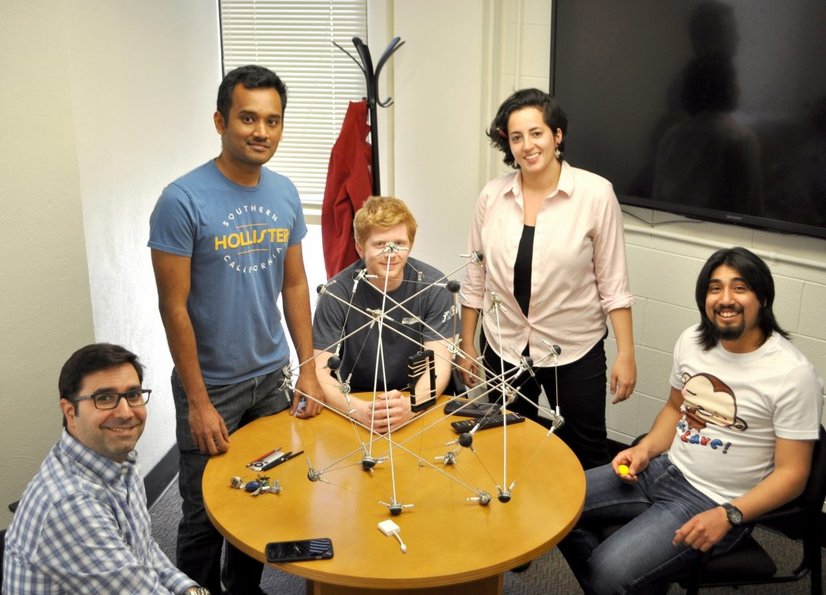 Christine Gebara and three other students work with Prof. Rimoli  on a tensegrity