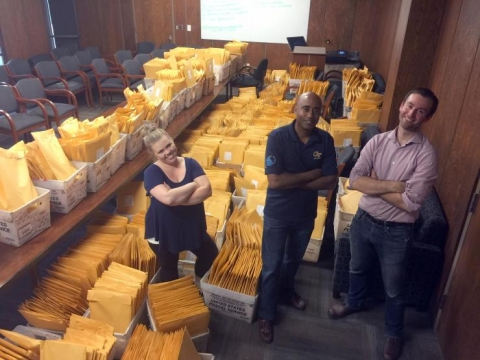 <p>Prof. <strong>Stephen Ruffin</strong>, center, with Georgia Space Grant Consortium staffers <strong>Alysia Watson</strong> and <strong>Michael Roberts</strong>, breathed sighs of relief late Thursday night after volunteers finished packaging the eclipse packs.</p>
