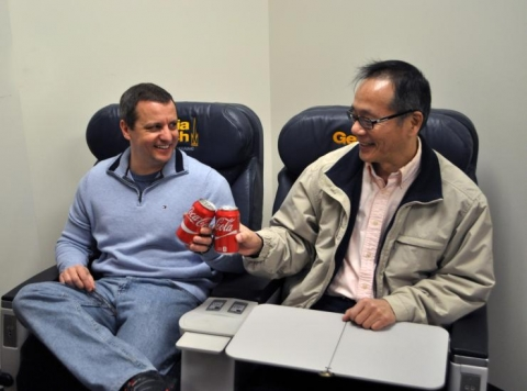 <p><strong>A toast to the future</strong>. Gary Weissel and GT-AE school chair Vigor Yang christened the first-class seating that's now available in MK 301.</p>
