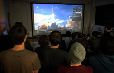 <p>A livestream of the Falcon Heavy launch is projected on a wall-to-wall, floor-to-ceiling screen in the Engineering, Science and Mechanics Building on February 6.</p>