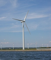 "A wind farm in Aalborg, Denmark shows an array of current-generation wind turbines.  The ARPA-E project could help lower the cost of manufacturing and operating future wind turbines by using ""circulation control"" technology to reduce complexity of the"