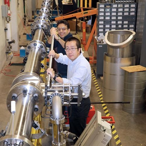 <p>Dr. Wenting Sun, foreground, is seen here with doctoral student Miad Karmini, working on the new Shock Tube that was installed in the Ben T. Zinn Combustion lab this year.</p>